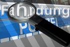 """Symbolbild Polizei: Schriftzug """"Fahndung"""" mit Lupe"""